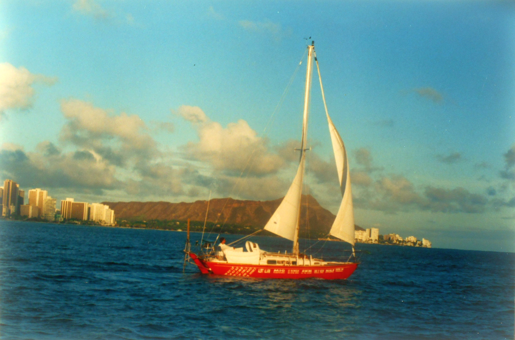 Mai Miti Vavau sailing out of Honolulu, with Diamond Head Crater in the background.